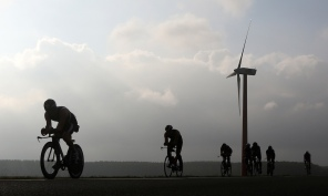 ALMERE, NETHERLANDS - SEPTEMBER 13: Participants pass windmills while competing in the cycling leg of the race during The Challenge Triathlon Almere-Amsterdam on September 13, 2014 in Almere, Netherlands. (Photo by Charlie Crowhurst/Getty Images for Challenge Triathlon) *** Local Caption *** ;